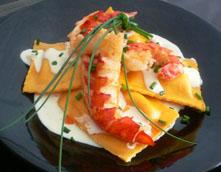 crab ravioli with grilled lobster in saffron cream sauce