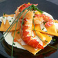 crab ravioli with grilled lobster in saffron cream sauce