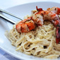 Marcella Hazan's Fettuccine in Cream and Butter Sauce Served with Grilled Jumbo Prawns