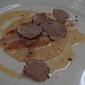 Tortelli di fegato grasso e patate con tartufo nero alle erbe e guanciale.