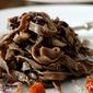 Tagliatelle di grano arso e cacao amaro con radicchio, bottarga e pecorino