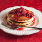 Eggnog Pancakes with Canberry-Orange Syrup