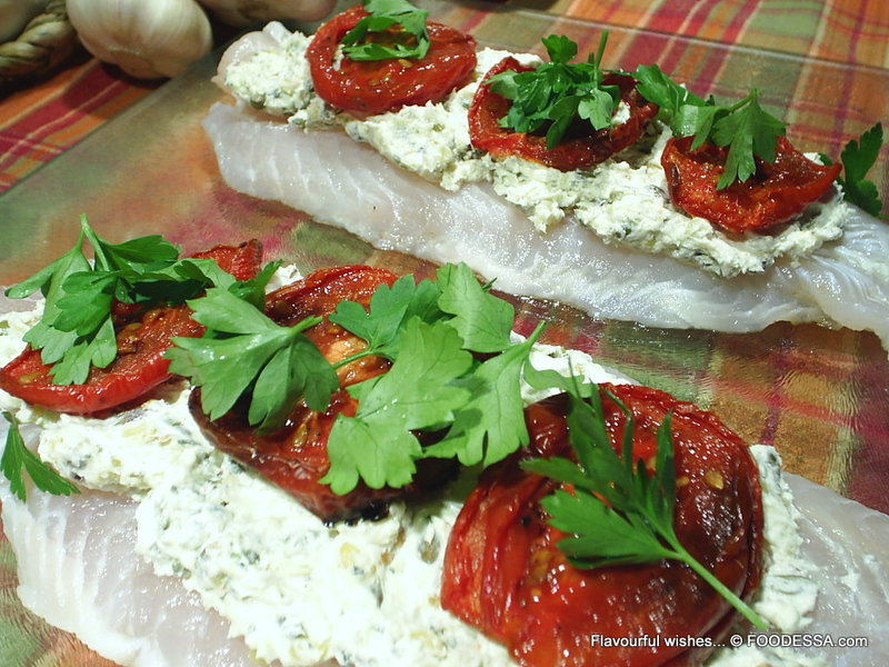 Fish stuffed fillet rolls with goat cheese roasted tomato for Stuffed fish fillets