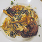 Roasted veal chops with black trumpet ragu and crispy artichokes
