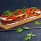 Roasted Cherry Tomato Bruschetta with Fresh Mozzarella and Guajilla Chile Oil