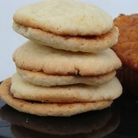 Coconut cookies filled with raspberry jam