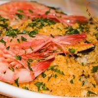 Cous cous piccante con frutti di mare e harissa