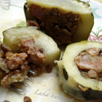 Zucchini stuffed with rice, lentils, Parmesan cheese and fresh sausage