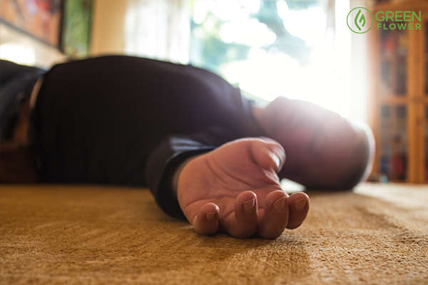 man lies unconscious