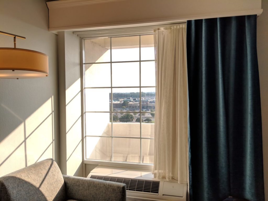 See the mall from your window in a comfortable chair at a room at Crowne Plaza Pittsburgh Bethel Park South Village area
