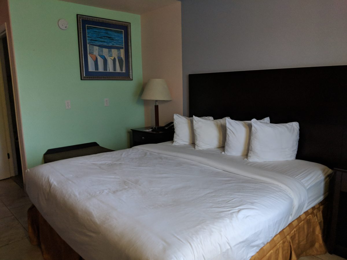 A picture of a king bed in a guest room at Ponce St. Augustine hotel