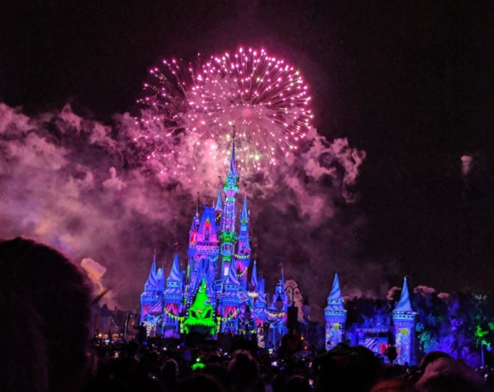 Fireworks over Cinderella Castle with Oogie Boogie projection during Not So Spooky Show at Mickey Halloween Party