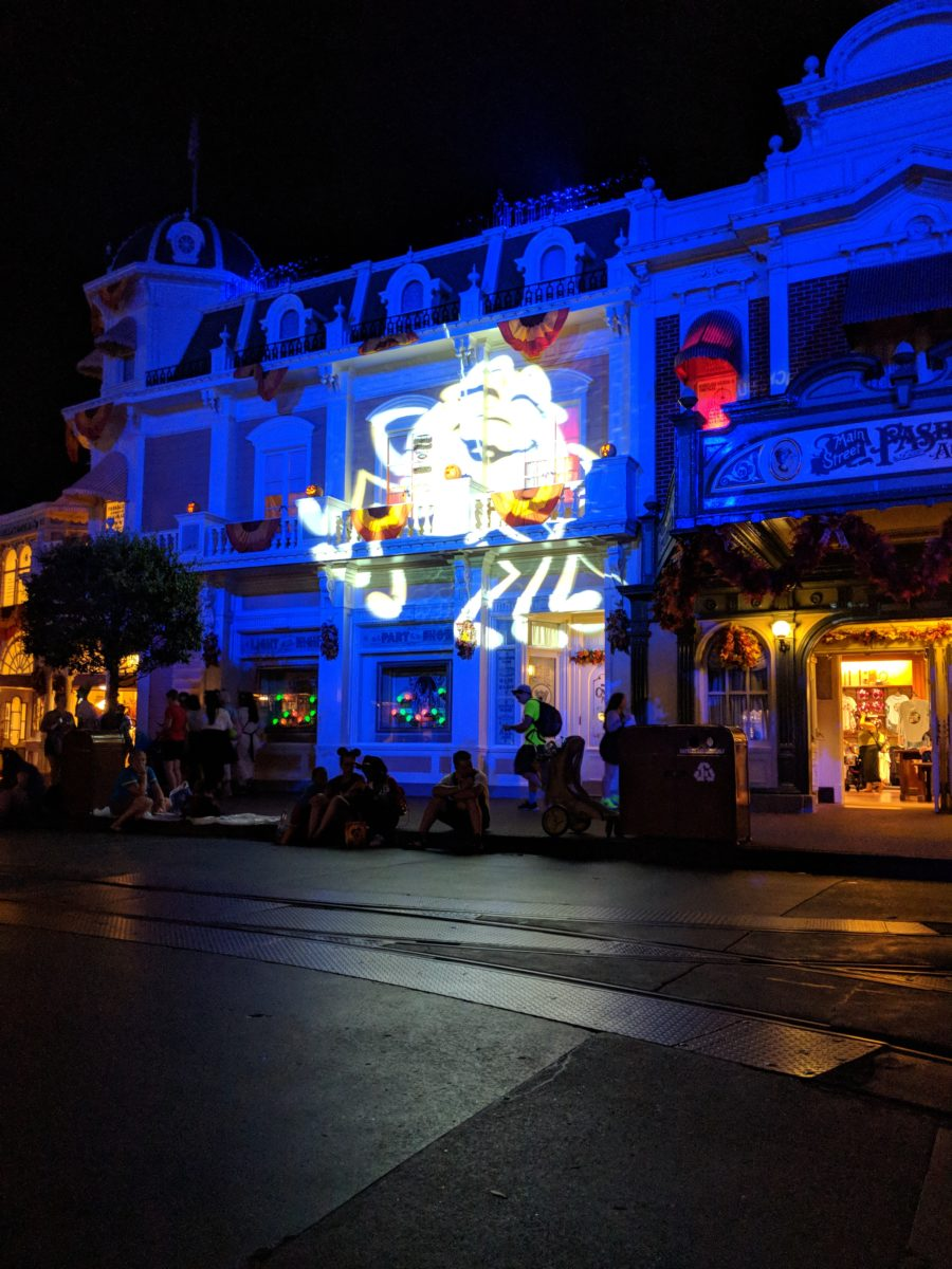 Halloween projection on side of building on Main Street in Magic Kingdom during Mickey's Not So Scary Halloween Party