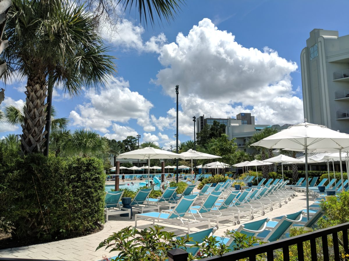 Lounge around & relax at the pool at Hilton Orlando Buena Vista Palace
