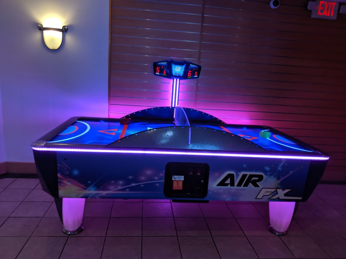 A picture of a an air hockey table at Hilton Orlando Buena Vista Palace Disney Springs arcade