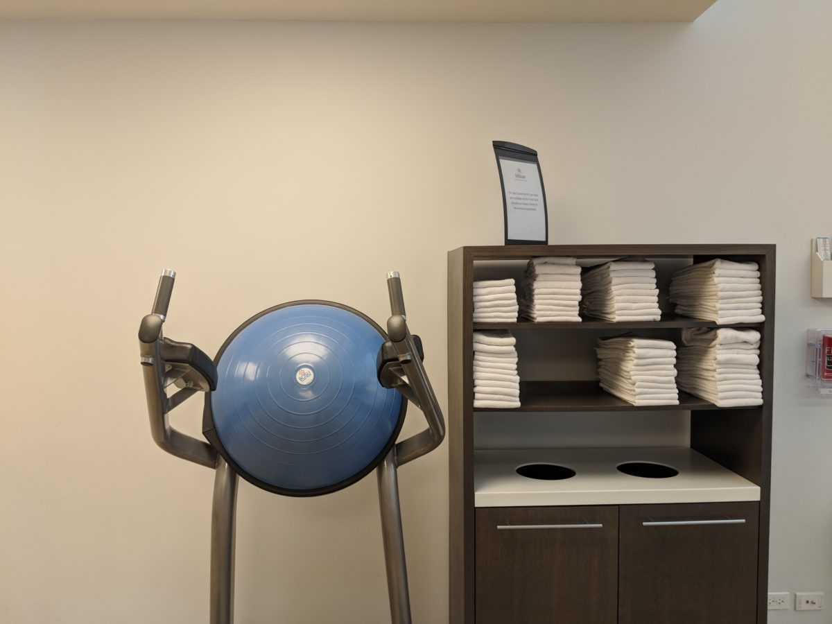 A picture of workout equipment & towels at the fitness center at Hilton Orlando Buena Vista Palace