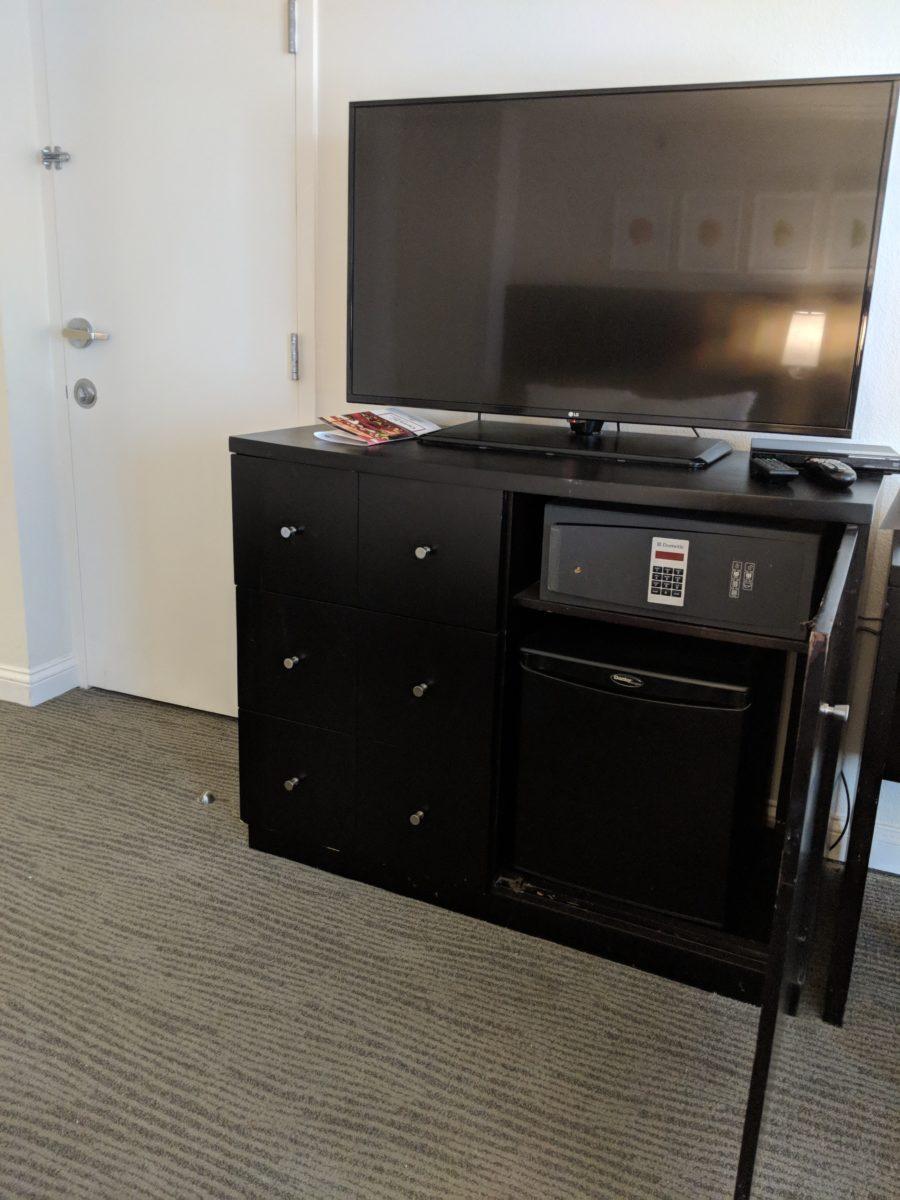 Guest rooms at Hilton Orlando Buena Vista Palace Disney Springs have large TVs, refrigerator