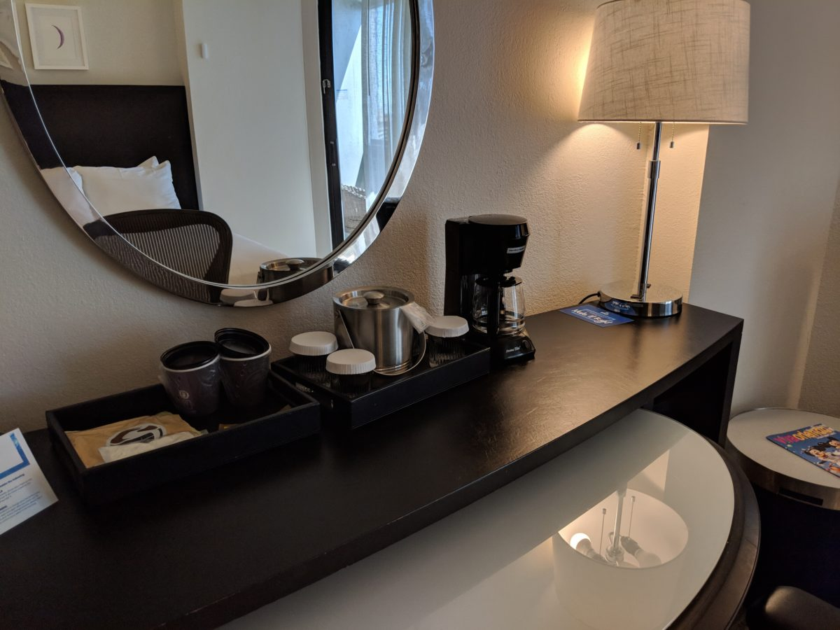 A picture of the desk & coffee maker at Hilton Orlando Buena Vista Disney Springs guest rooms