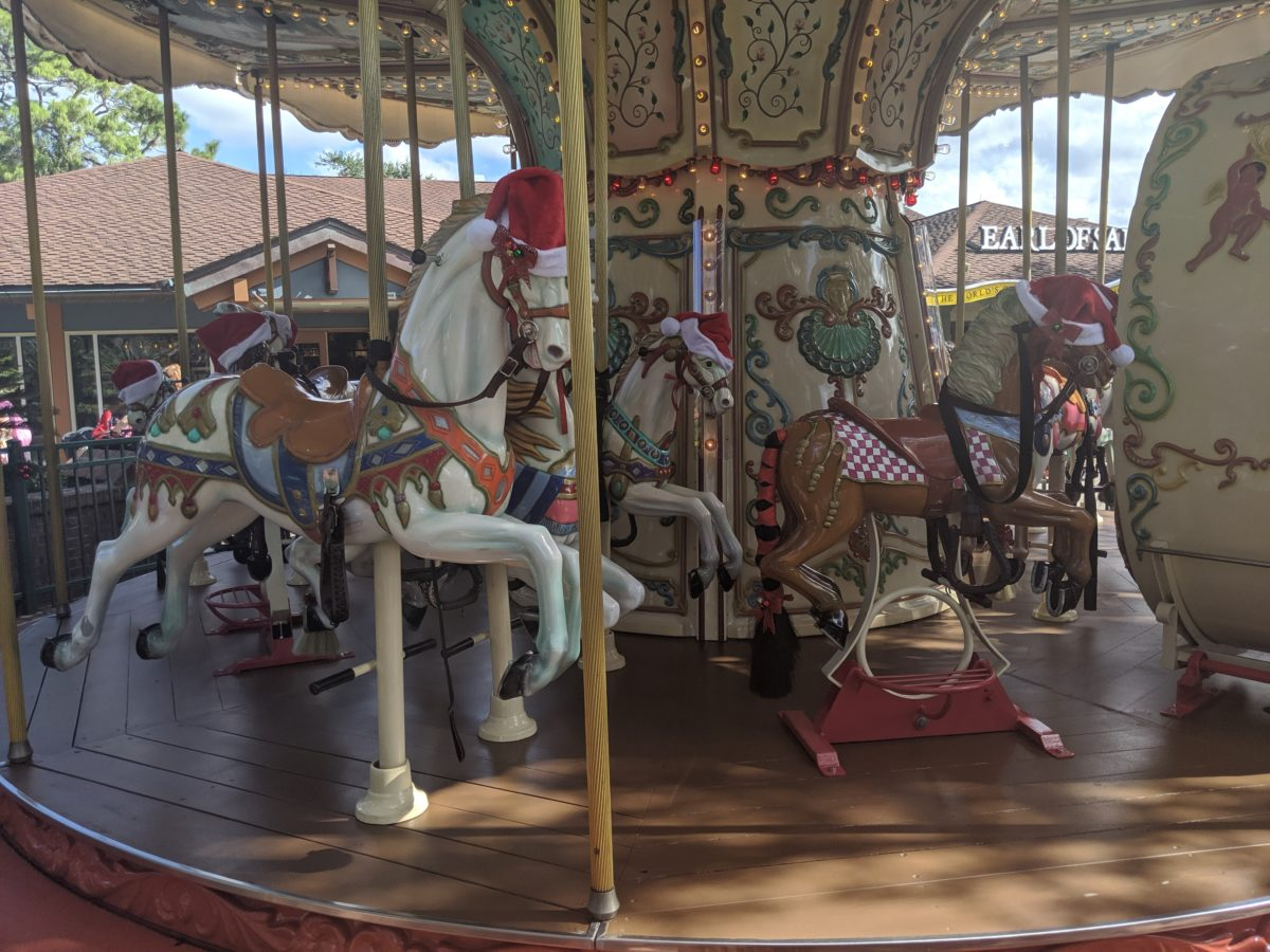Christmas Santa hats are on the horses on the Carousel Marketplace in Disney Springs during the holiday season