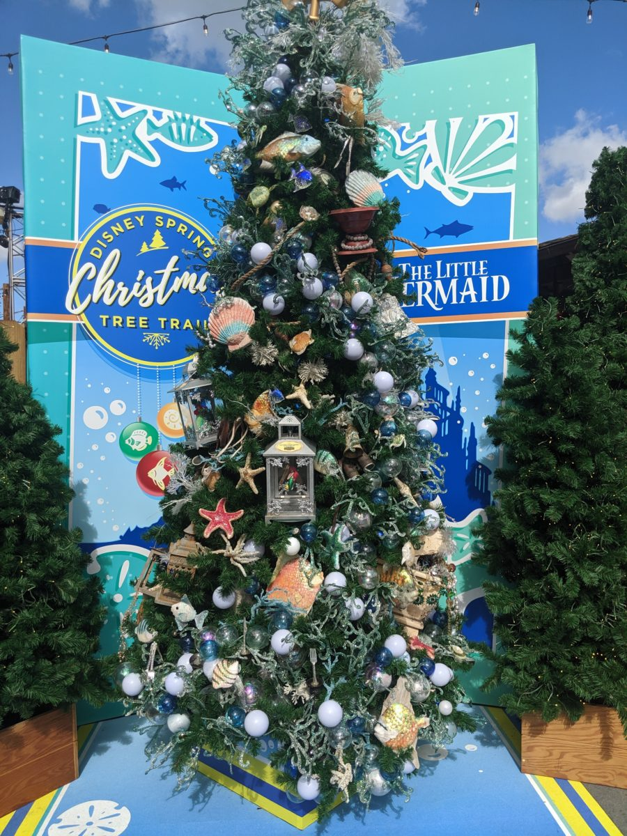 A picture of the Christmas Tree Trail at Disney Springs, the Little Mermaid tree