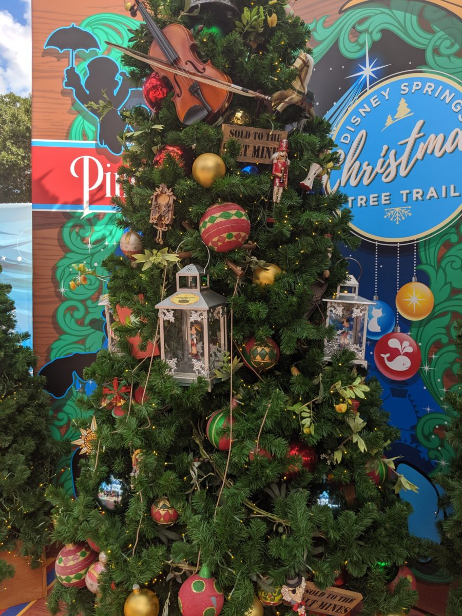 Disney Springs Christmas Tree Trail at Disney World has a specific Pinocchio tree