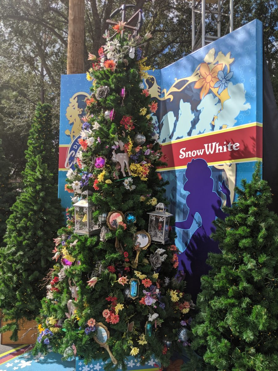 Disney Springs has Christmas trees themed to specific movies like Snow White & the seven dwarfs