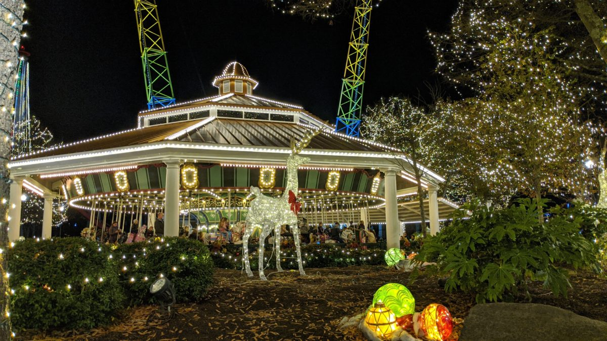 A picture of a holiday decorated carousel at Winterfest at Carowinds theme park
