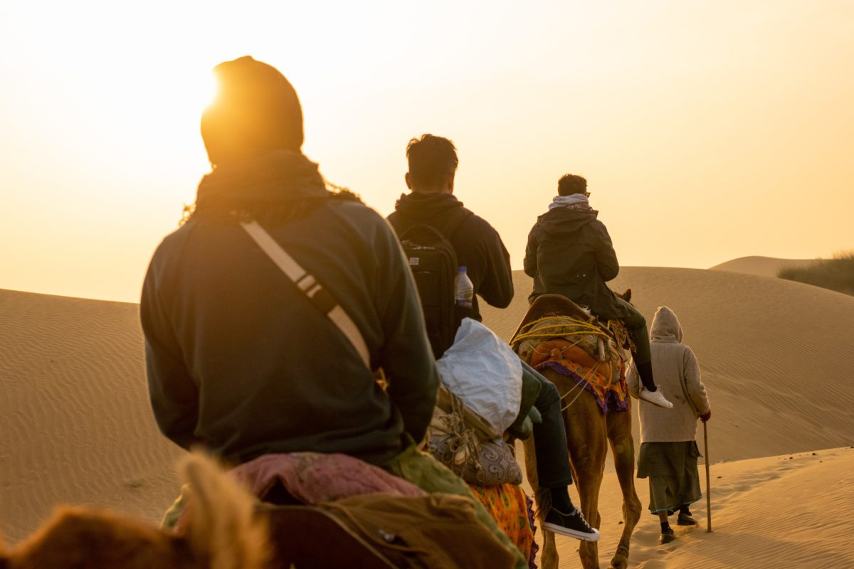 Enjoy a sunset camel safari ride in Jaisalmer, India