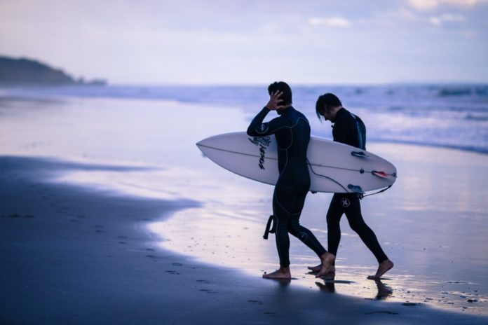 A picture of surfers at a beach in Torquay. Our list of the best hotels in Torquay, Victoria, Australia