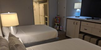 A picture of the guest rooms and queen beds at Wyndham Lake Buena Vista Disney Springs Resort Area