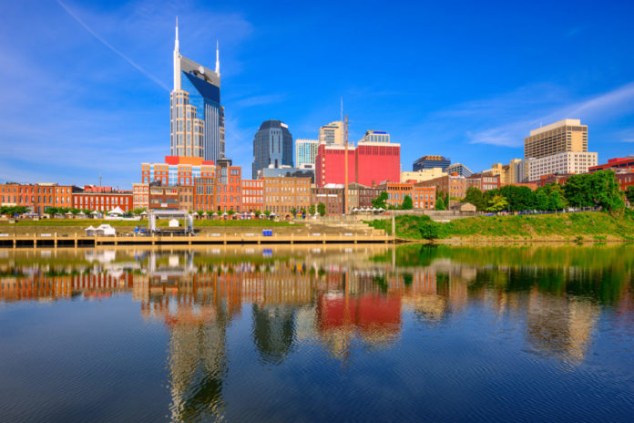 Nashville, Tennessee, USA downtown city skyline on the Cumberland River. Learn how to win a free vacation there