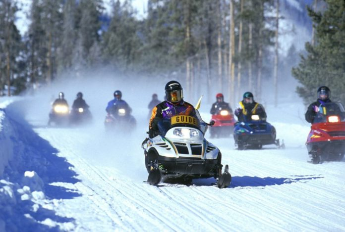 Save money on snowmobile tour of Yellowstone National Park