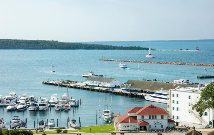 Learn the history of Mackinac Island in Michigan & where to stay or camp