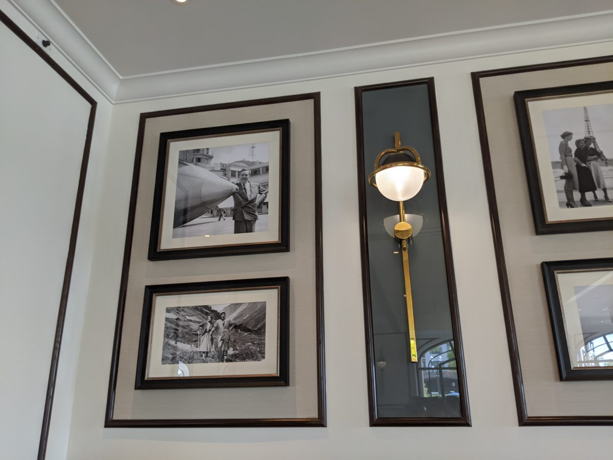 A picture of the photos of Walt Disney at the quick service dining restaurant at Disney's Riviera Resort