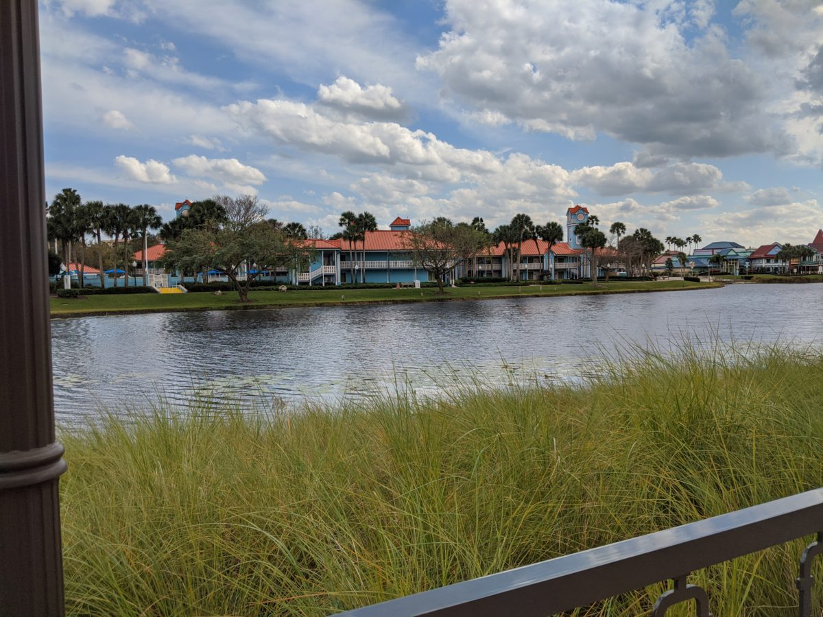 See the Caribbean Beach Resort from the pool at Disney's Riviera Resort in Orlando, Florida