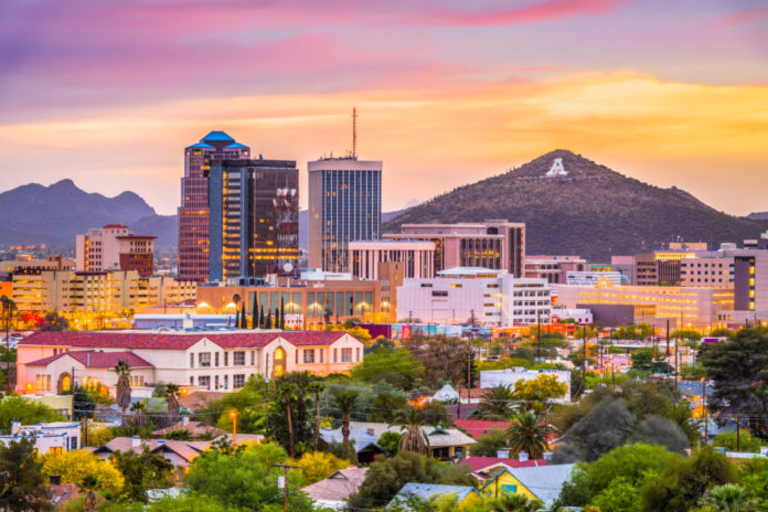 Tucson, Arizona, USA downtown skyline with Sentinel Peak at dusk. Find out how to save money on a luxury hotel & activities there.