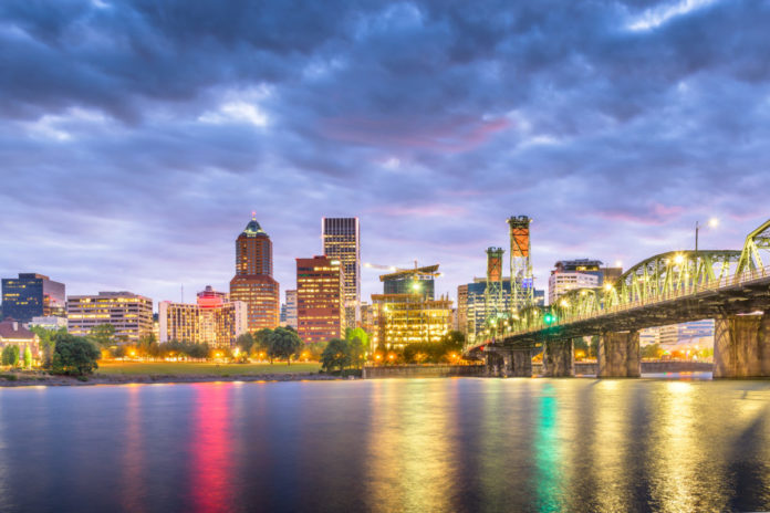 Portland, Oregon, USA skyline at dusk on the Willamette River. Save money on hotels there
