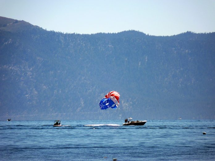 Get spectacular views of beautiful Lake Tahoe, the lakeside scenery, the forest and the surrounding mountains by parasailing