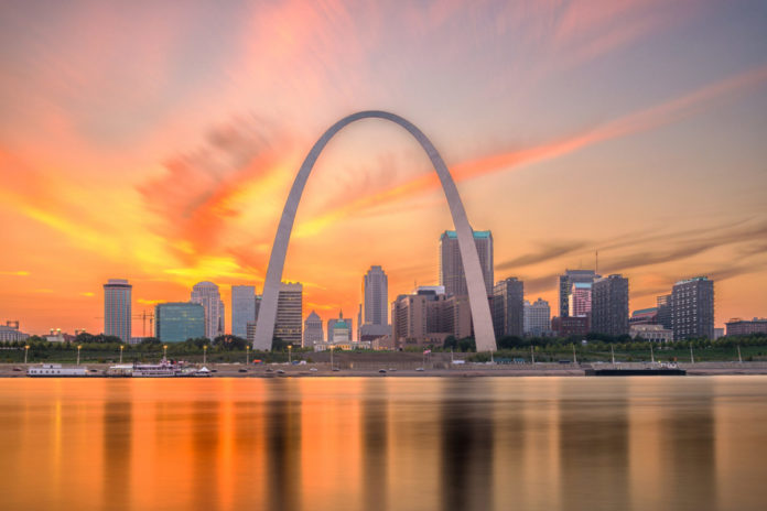 St. Louis, Missouri, USA downtown cityscape with the arch and courthouse at dusk. Find out how to win a free trip there