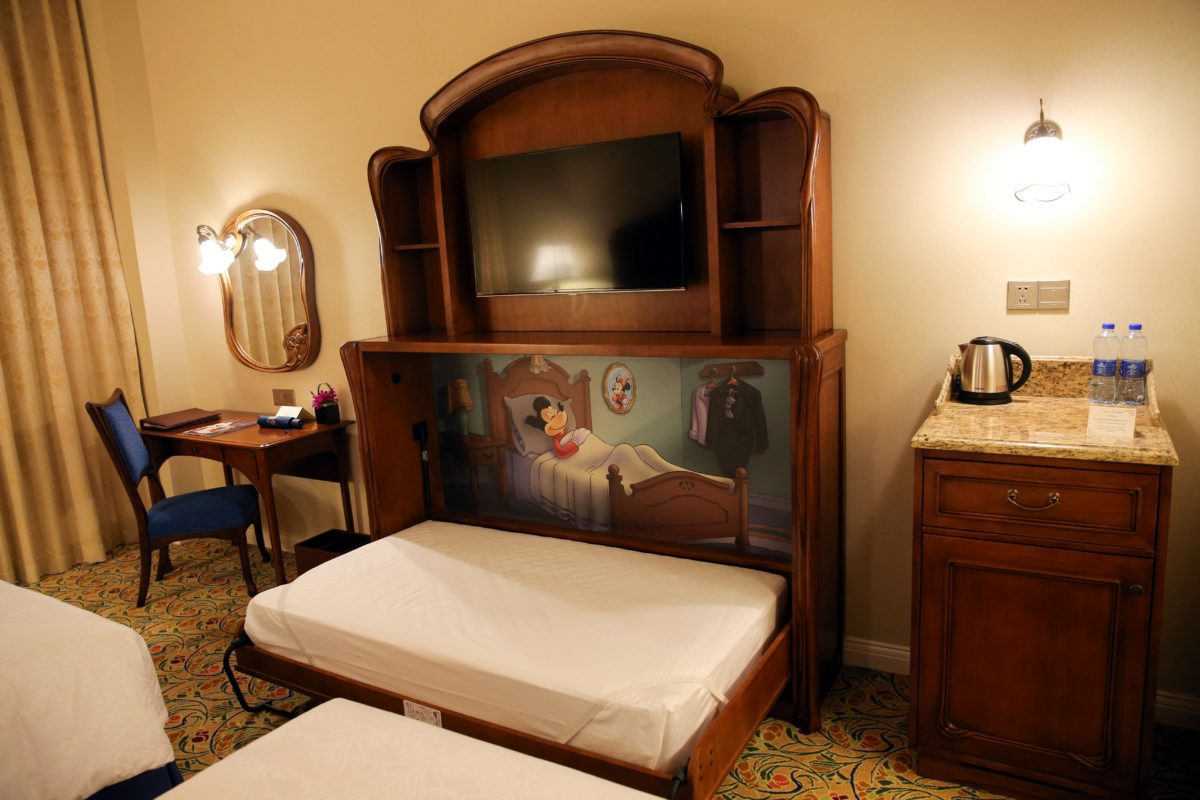 A picture of a bed at a Shanghai Disneyland Hotel suite