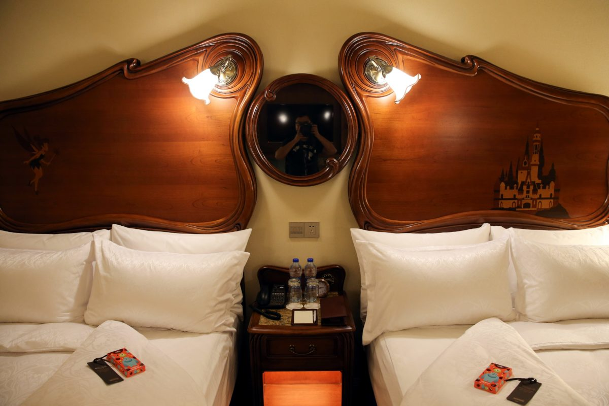 See Tinker Bell & a Castle on the headrest of the beds at the Shanghai Disneyland Resort Hotel