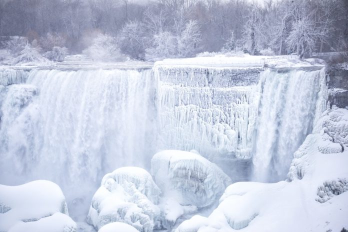 Enjoy a Niagara Falls winter vacation with a discount ticket for a guided tour of the frozen falls