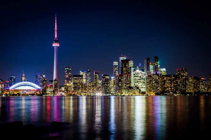 Night View of Downtown Toronto from Toronto Islands with the Lake Ontario, Canada. Learn how to get a free trip there