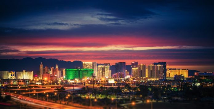 City of Las Vegas Skyline at Scenic Dusk. Colorful Lights of the World Famous Sin City. Nevada, United States. Learn how to travel there for free