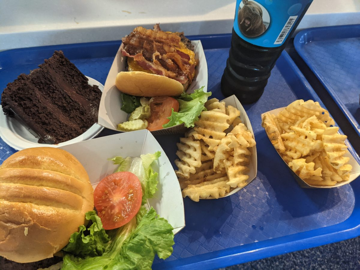 Enjoy burgers, fries, & cake at Altitude Burger a quick service restaurant at SeaWorld Orlando theme park