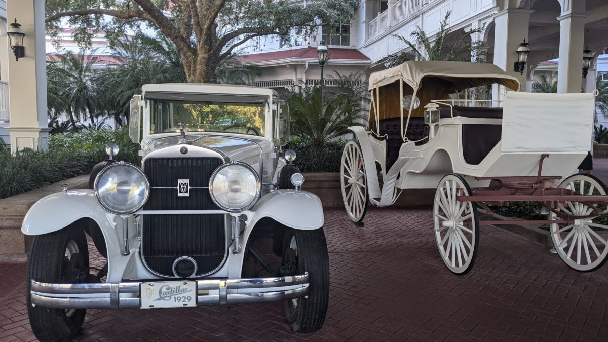 Classic cars in front of Grand Floridian make it a wonderfully themed Disney World hotel
