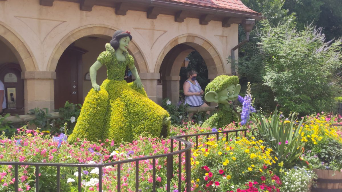 See topiaries of popular Disney characters like Snow White & Dopey at the Flower & Garden Festival at Epcot