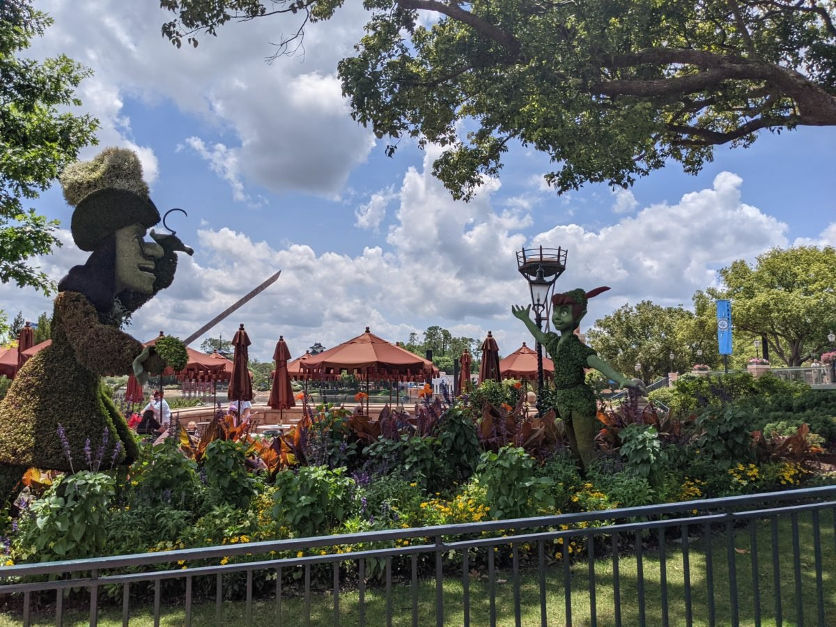 Peter Pan & Captain Hook topiaries are in the United Kingdom Pavilion at Epcot as part of Disney World's Flower & Garden Festival in 2021