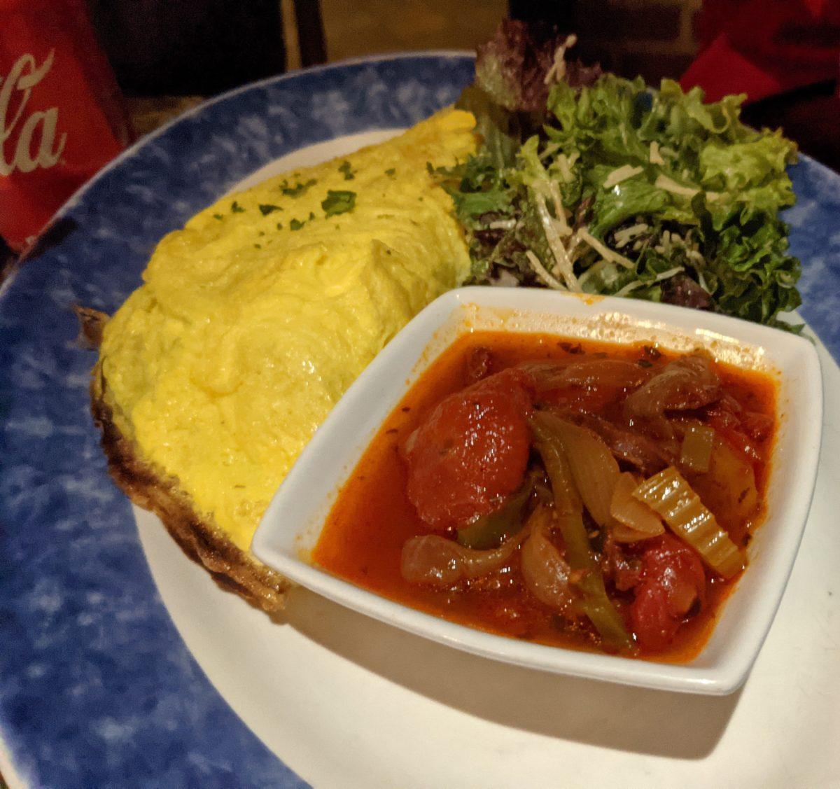 The Bistro Omelette at Blue Talon Bistro in Williamsburg, Virginia has Black Forest ham, cheese & Basque sauce