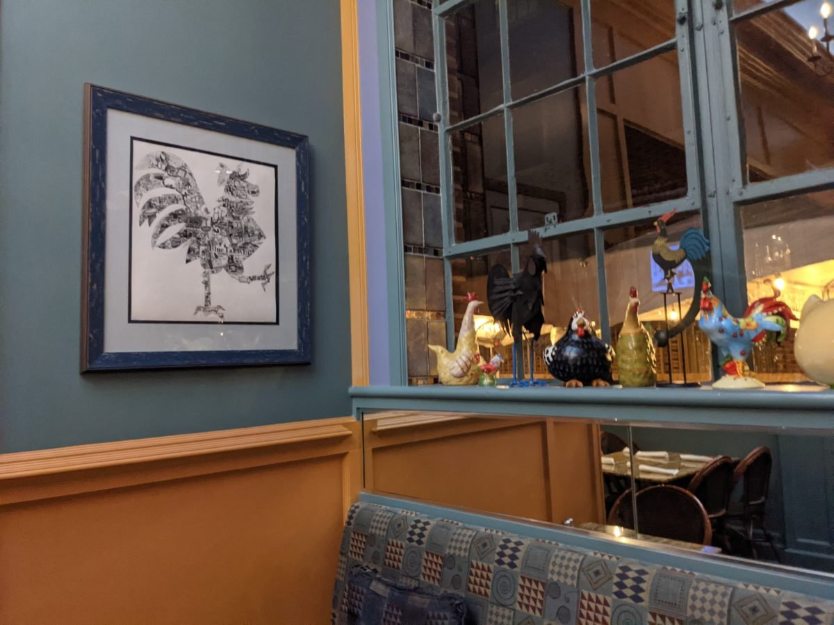Rooster pictures & decor make a great casual fun atmosphere at Blue Talon Bistro in Williamsburg